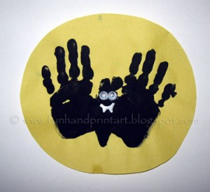 Handprint-bat-flying-over-moon-craft-300x275